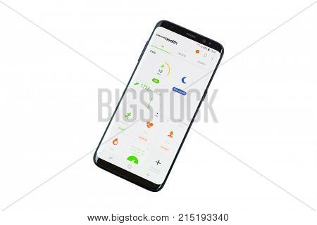 GDANSK, POLAND - NOVEMBER 23, 2017: Brand new black Samsung Galaxy S8 over white background. Samsung Galaxy Health application on the screen.