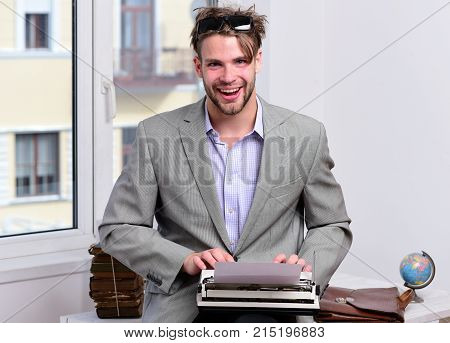 Writer Or Businessman Wearing Grey Suit. Young Author Or Editor