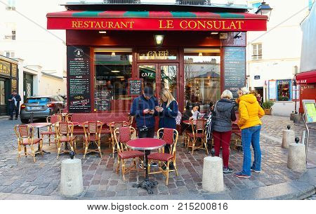 PARIS , France- November 22, 2017: View of typical paris cafe in Paris. Montmartre area is among most popular destinations in Paris, Le Consulat is a typical cafe.
