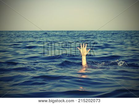 Man While Asking For Help Drowning In The Sea With Vintage Effec