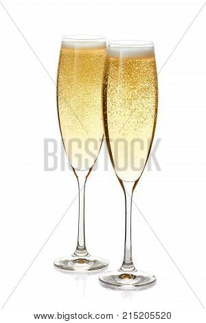Two glass of champagne with foam and bubbles isolated on white background