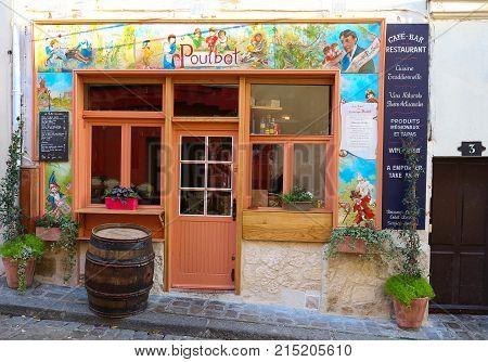 PARIS , France- November 22, 2017: View of typical paris cafe in Paris. Montmartre area is among most popular destinations in Paris, Poulbot is a typical cafe.
