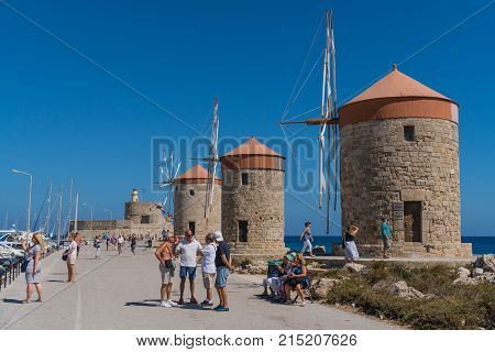 Rhodes, Greece, September 2017 - Windmills in the port of Rhodes, Greece