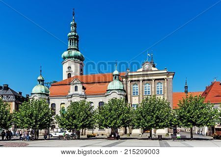 PSZCZYNA, POLAND - SEPTEMBER 9, 2017: Lutheran church and town hall in the main square. City was founded 1303 and Lutheranism was introduced to Pszczyna in 1568 by Duke Karol Promnitz.