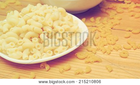 Macaroni boiled close up and raw macro photo graphy retro color tone.