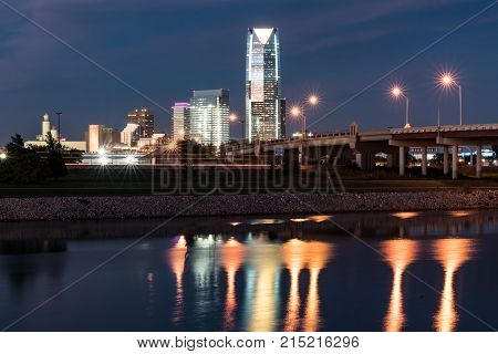 OKLAHOMA CITY, OK - OCTOBER 11, 2017: Skyline of Oklahoma City OK at night with reflection in the Oklahoma river
