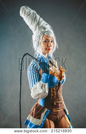 Beautiful Woman Trainer With The Whip In A Sexy Circus Suit