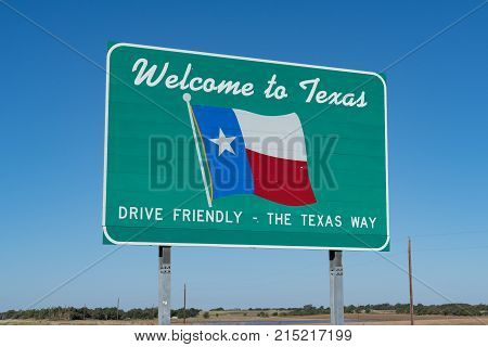 Welcome to Texas Sign on the road at the state border