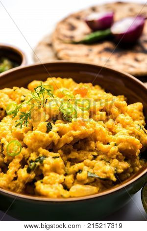 Pithla Bhakar or spicy besan curry or zunka is a popular food recipe made up of Gram flour and jowar flour from Maharashtra India