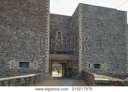 Dover Castle Dover Kent UK - August 17 2017: An entrance to the casle keep. Summer shot with tourist inside the entrance.
