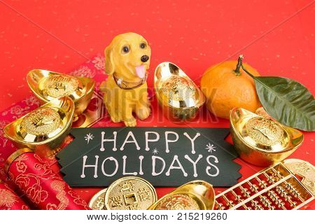 happy Holiday written on red background with Chinese new year ornament--gold ingot,firecrackers and golden abacus