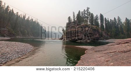 Confluence where the Flathead and Spotted Bear Rivers meet in the Bob Marshall wilderness area during the 2017 fall fires in Montana United States poster