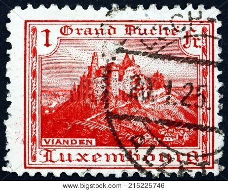 LUXEMBOURG - CIRCA 1921: a stamp printed in Luxembourg shows Vianden castle circa 1921