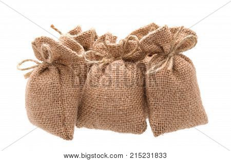 Group bags of sacking isolated on white background