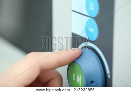 Hand rotating regulation knob concept of technical support worker adjusting new advanced equipment.