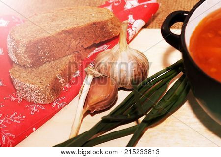 Bowl of minestrone soup with bread and garlic food