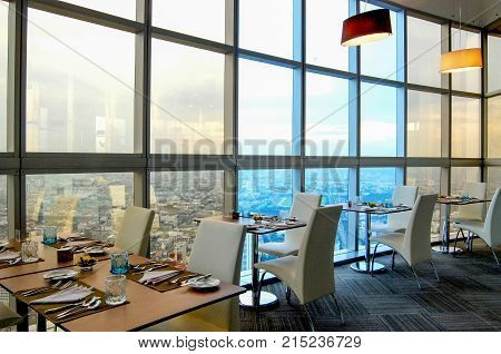 dinning table on glass building for dinner