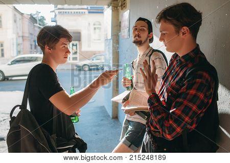 Geek boy resist bad influence. teenage smoking addiction bad habits concept. Modern urban youth lifestyle