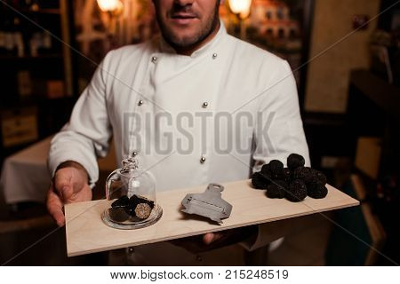 restaurant chef delicacy. truffle vegan food mushroom. waiter service meal concept