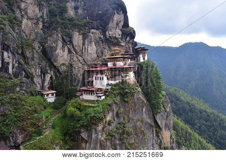 Tiger's Nest monastery Bhutan Himalayas on side of mountain with rock face