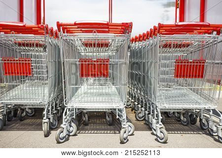 Row of supermarket shopping cart trolleys. Shoping concept