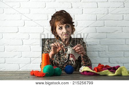 Old Lady Or Grandmother With Needle And Yarn.