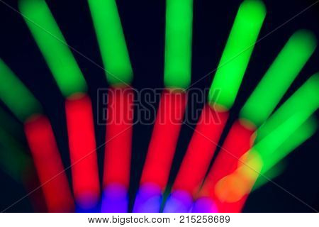 Abstract multi color of glow fluorescent on black background