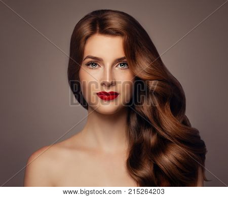 Young Woman with Long Healthy Wavy Hairstyle. Girl with Hair Haircare Concept
