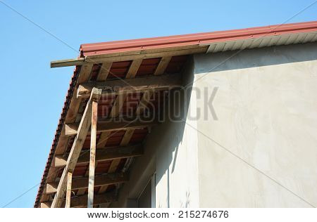 Repair and installing house roof eaves soffits and fascia boards.