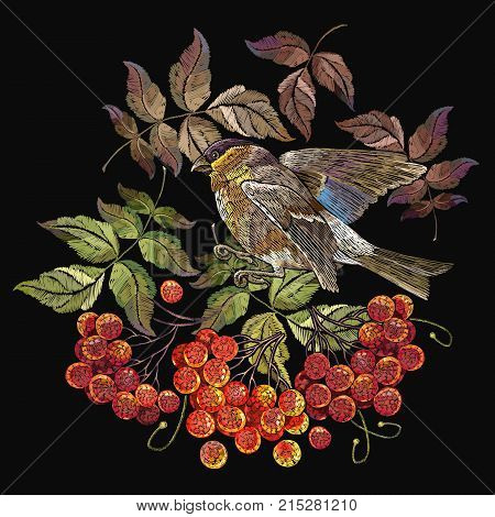 Embroidery bird sitting on mountain ash branch. Fashionable template for design of clothes. Titmouse on a branch of mountain ash