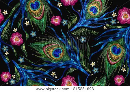 Embroidery peacock feathers and roses flowers seamless pattern. Classical fashionable embroidery beautiful peacocks feathers. Fashionable template for design of clothes. Tails of peacocks vector