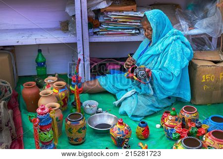 KOLKATA WEST BENGAL INDIA - DECEMBER 3RD 2016 : Colourful handicrafts are being prepared for sale in Kolkata in handicrafts trade fair. Handicrafts are rural Industry in West Bengal.