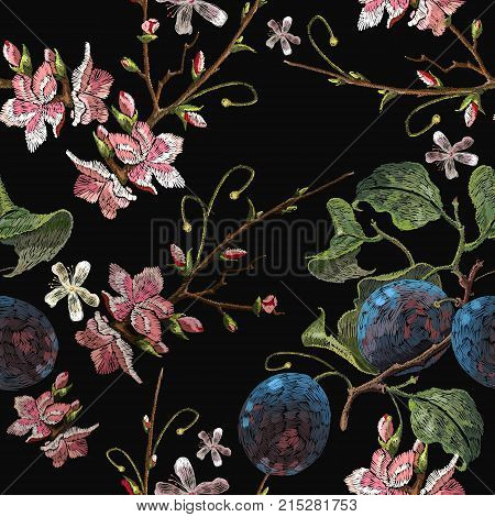Embroidery plums branch and pink cherry blossom seamless pattern template fashionable clothes t-shirt design. Classical embroidery blossoming plum and cherry flowers on black background