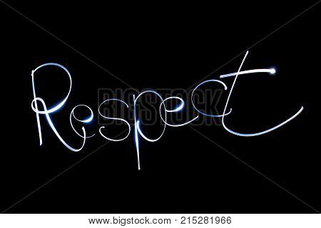 Light painting of the word RESPECT on black background.