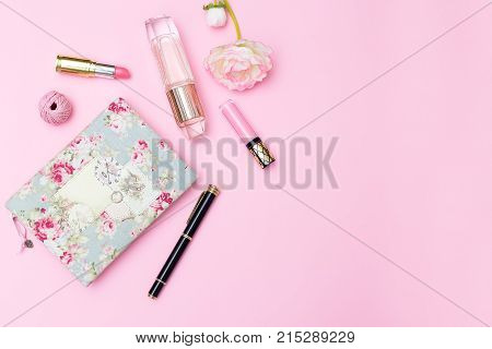 Women's cosmetics and accessories on a pink background. Mock up