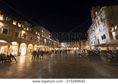 ASCOLI PICENO, JULY 10, 2017: Ascoli Piceno (Marches Italy): the famous Piazza del Popolo the medieval main square of the city at evening with people