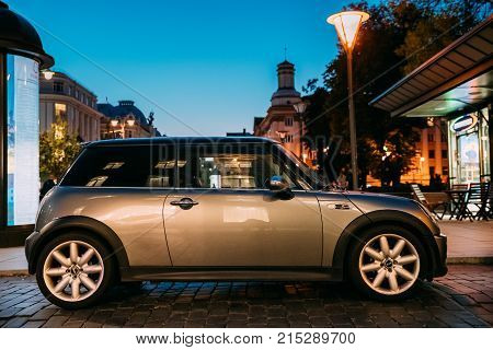 Vilnius, Lithuania - September 29, 2017: Side View Of Gray Color Mini Cooper Car Parking On Street In Evening.