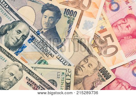 Currencies And Money Exchange And International Trading Concepts. Pile Of Various Currencies From Di