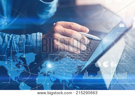 Concept of virtual diagram, graph interfaces, digital display, connections, statistics icons.Man using stylus pencil on digital display of contemporary electronic tablet.Blurred background. Horizontal
