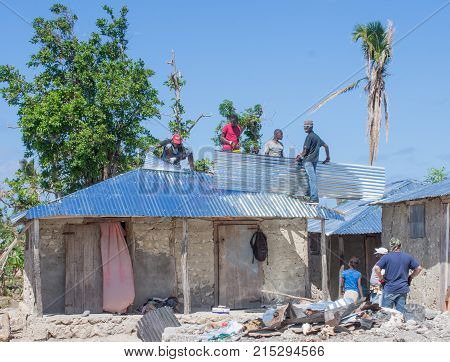 Men working on Village of Bonbon Haiti homes after hurricane Matthew destroyed it in October 2016.