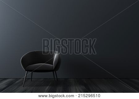 Gray room interior with a black wooden floor and a soft gray armchair standing near the wall. Concept of a waiting room. 3d rendering mock up