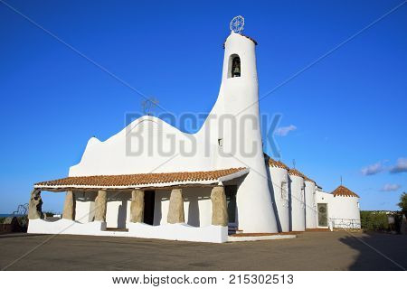 PORTO CERVO, ITALY - SEPTEMBER 21, 2017: A view of the Stella Maris Church in Porto Cervo, in Sardinia, Italy, built in the 1960s by the architect Michele Busiri Vici, in the neo-Sardinian style