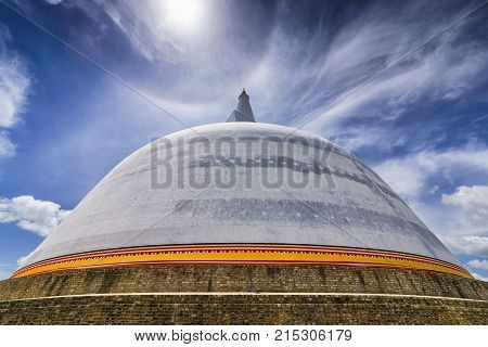 Anuradhapura, Sri Lanka - August 16, 2017: View of Ruwanwelisaya stupa, a hemispherical structure containing relics. The stupa is one of the world's tallest monuments, standing at 103 m (338 ft)