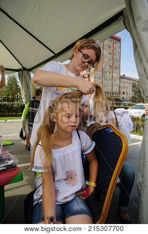 Hairdresser Makes Hairstyle For Young Girl