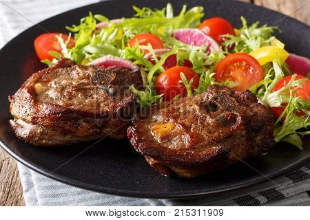 Spicy Delicious Lamb Steak And Salad From Radish, Tomatoes, Pepper And Lettuce Close-up. Horizontal