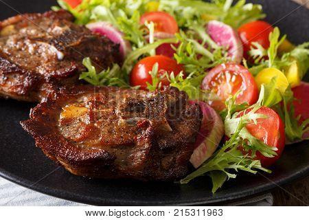 Roasted Lamb Steak And Fresh Vegetable Salad Close-up. Horizontal