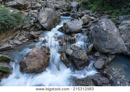 Mountain river and stones landscape natural environment. Hiking in the alps. Grawa Waterfall in Stubai Valley Tyrol Austria