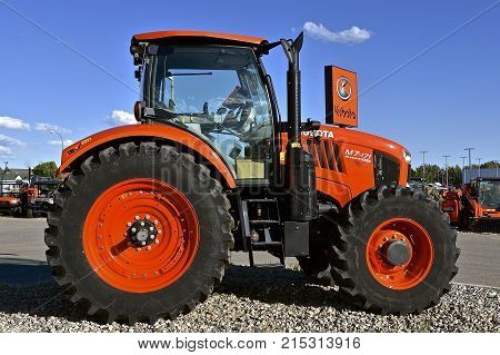 FARGO, NORTH DAKOTA, Aug 12, 2017: The Kubota M7-71 tractor on display is a of product of Kubota Corporation, a tractor and heavy equipment manufacturer based in Osaka, Japan, established in 1890.