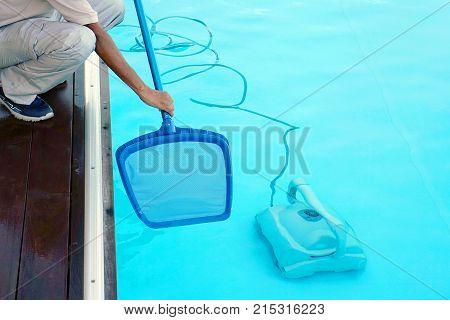 Pool cleaner during his work. Pool cleaner