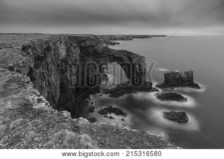 Beautiful Black And White  Landscape Image Of Green Bridge Of Wales On Pembrokeshire Coast In Wales